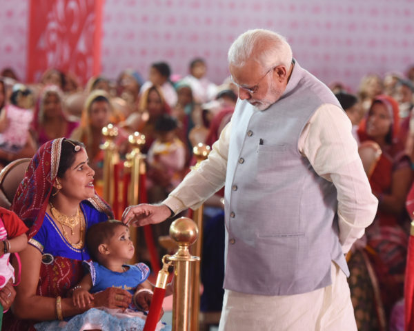 The Prime Minister,  Narendra Modi interacting with the Beti Bachao Beti Padhao beneficiaries, in Jhunjhunu, Rajasthan on March 08, 2018.