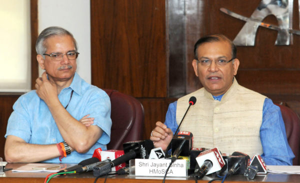 The Minister of State for Civil Aviation, Jayant Sinha briefing the media on the proposed Passenger Charter and aspects of Air Sewa.., in New Delhi on May 22, 2018. The Secretary, Ministry of Civil Aviation, R.N. Choubey is also seen.